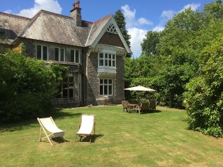 Country House With Bluebell Wood In Dartmoor National Park