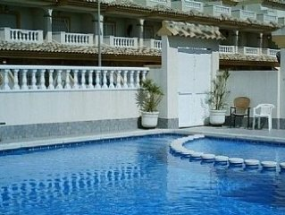2 bedroom Townhouse with Communal Pool, solarium, front and rear patios