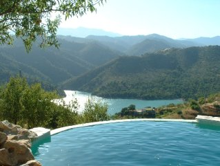 Country Villa with large infinity pool in a rural location overlooking lake