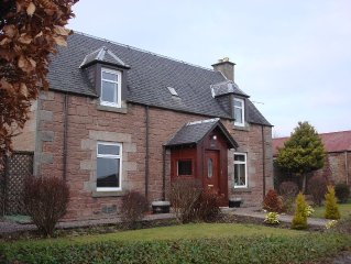 A century-old stone farmhouse with private garden and great views of Inverness