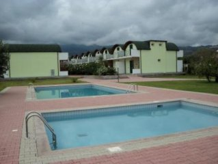 Private Complex  5 min. walk from beach  24 houses share 2 pools and and gardens