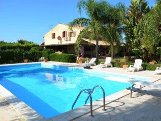 Beautiful villa with a big pool, lawns and a deli