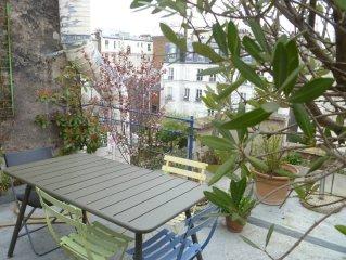 appartement de caractère avec terrasse dans un quartier très animé, proche metro