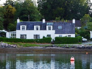 Gallanach Cottage lochside setting with a large enclosed garden