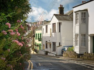Spacious 4-bed cottage with parking, garden, & large balcony, in village centre