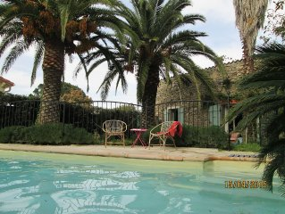 Pretty stone cottage, in small town in Pyrenees. Pool, child friendly garden