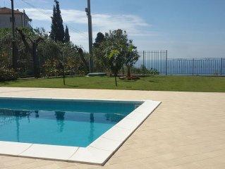 Bilocale climatizzato con piscina, 4 posti letto, vista mare giardino parcheggio