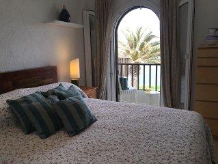 Apartment set in beautiful gardens & superb views of Mahon harbour.
