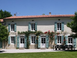 Spacious farmhouse with private large heated enclosed pool and extensive grounds