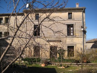Stone village house with stunning views of  old St. Siffret, near Uzes