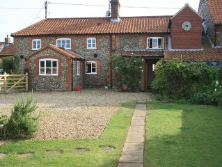 DOG FRIENDLY FLINT COTTAGE WITH SWIMMING POOL, AGA, OPEN FIRE  SLEEPS 8