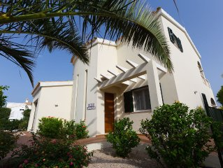 Villa With Private Pool in idyllic setting surrounded by palms and flowers.