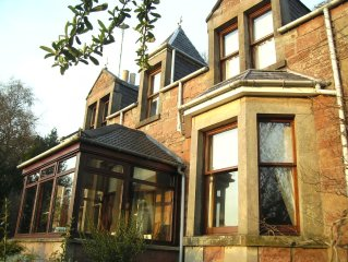 Traditional highland home with secluded garden and panoramic views of Inverness