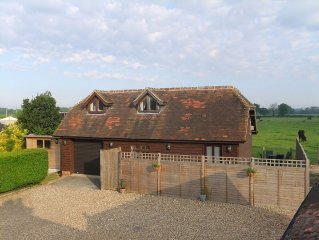 Pretty self contained Holiday let for up to 4 people in rural setting in Kent.