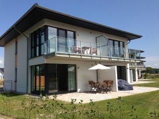 Ankommen & wohlfühlen: moderne Neubau-Ferienwohnung 'Beach Home'