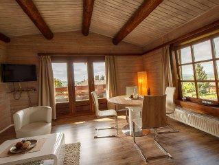 Gemütliches Blockhaus mit 2 neu renovierten Wohnung am Hang in ruhiger Lage