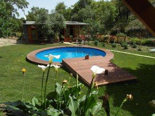 Holzhaus mit Wintergarten und Pool in Alleinlage
