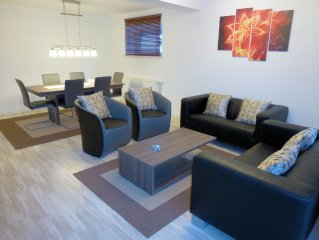 Large modern apartment for 6 people with garden next to the forest