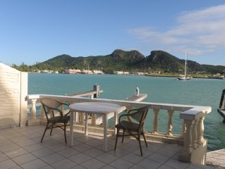 Villa right on the water in Caribbean Marina, 5 minutes to superb beach