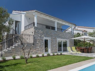 New, modern, of olive trees bordered villa with pool, near the beach