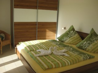 modern apartment with wooden deck, large garden, barbecue area, a few minutes f