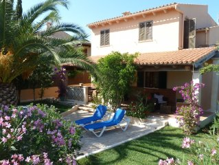 Casa dos Palmeras, cozy and quiet cottage with sea views and Wi-Fi
