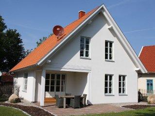 """Exkl. Ferienhaus """"Seegarten """" in Strandnahe mit Dampfsauna, Kamin und W-LAN"""