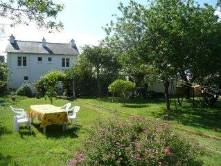 Schönes Ferienhaus in bester Lage direkt an der Küste, kostenloses WLAN & Garten