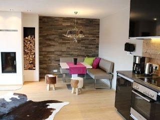 Winterwellness & Sommertraum im Zentrum: Design-Wohnung mit Saunen & Aussenpool