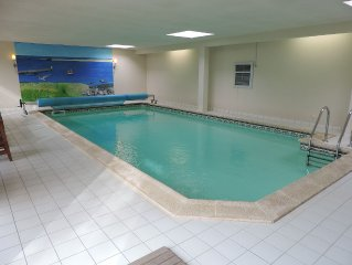 Home and heated indoor pool with sauna, wifi