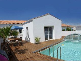 Villa neuve avec piscine chauffée et abri coulissant au Château d'Oléron