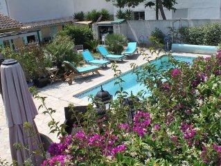 appartement F2 dans villa avec piscine