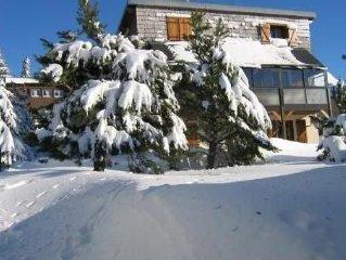 Appart  SUPER BESSE dans chalet  plein pied vue montagne et lac ( WIFI ) 68 m²