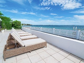 Beautiful, modern oceanfront house. Large patio, beach & dock. Low rates Sep/Oct