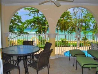 Beachfront Condo with pool and Panoramic View of Beach and Ocean