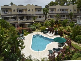 Beautiful Condo with WiFi & Balcony Overlooking Pool & Garden – Steps to Beach