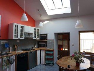 Appartement plein de charme, avec terrasse, au centre historique de Cluny