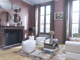 Très bel appartement de 90m2 dans immeuble pierre du 19ème siècle avec parking!