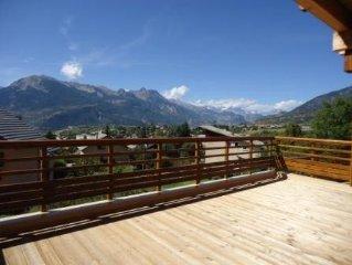 Appartement avec grande terrasse au soleil et vue sur les montagnes