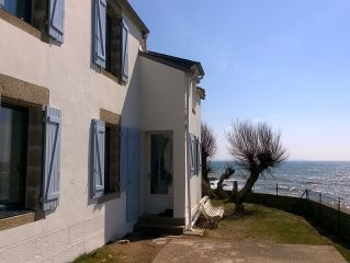 House on rocky promontory facing the sea. Private beach access