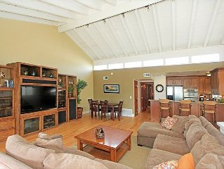 Lots of room, steps from the sand! Add downstairs condo for big groups!  #638766