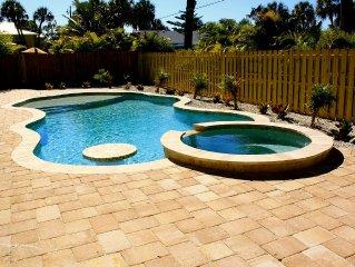 Beautifully Updated Heated Pool Home 3 bed/3 bath! Short walk to beach!
