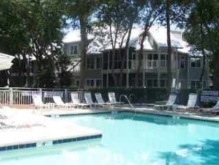 Private end unit beside creek/golf course, steps from pool, hot tub and barbecue