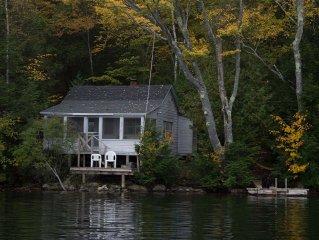 Private three season cabin nestled in woods on shore of pristine Maine lake