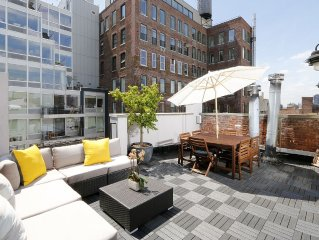 Elegant 2-Bed 2-Bath Triplex With Private Roof Terrace and Empire State Views