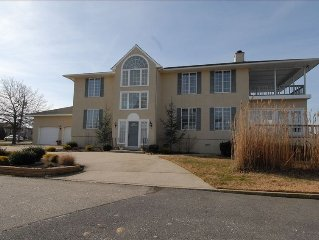 Bayfront Home with Spectacular Sunsets and Minutes to the Beac