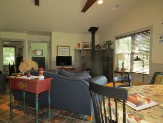 Comfortable Great Room with wood stove and stunning view of the Blue Ridge