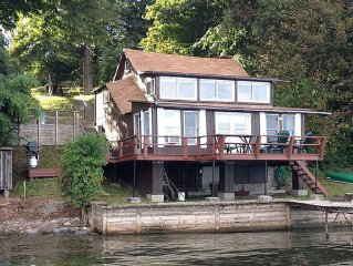 Family friendly Finger Lakes Cottage, private flat beach, minutes from Geneva