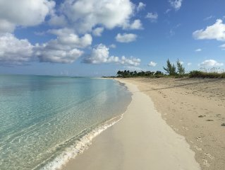 A few steps from the door and you're on Grace Bay Beach!