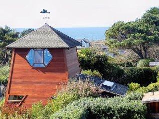 Sweeping ocean views nestled in exquisite private garden